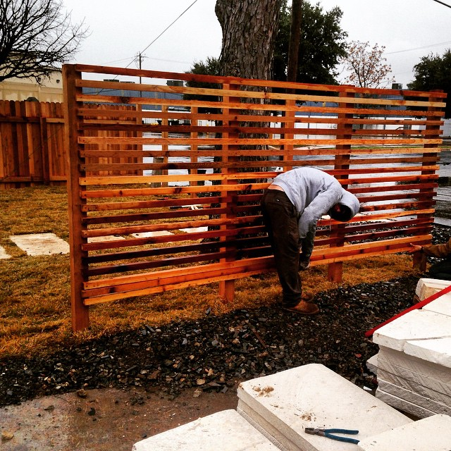 Super cool modern horizontal fence and screen going in today!