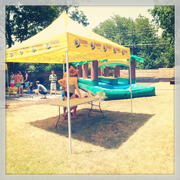 Did you know we worked slip and slides into our landscapes?! It's hard to see, but our latest patio and raised metal planters are in the background! Check it out! #slipandslide #atx  #outdoorliving #hot #summer #funinthesun