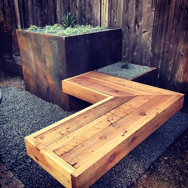 New modern courtyard style backyard on it's way to completion! More photos to come soon! Loveeeee these benches the guys have built! And paired with those planters!! This is one you don't want to miss!! #modern #atx #austin #bench #landscape #metal #metalplanter #amazing #dontmissthis